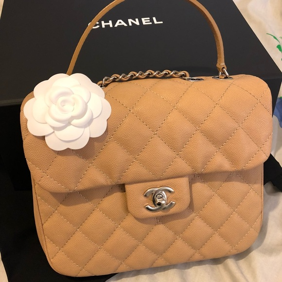 615c7c94c524 Urban Companion. NWT. CHANEL